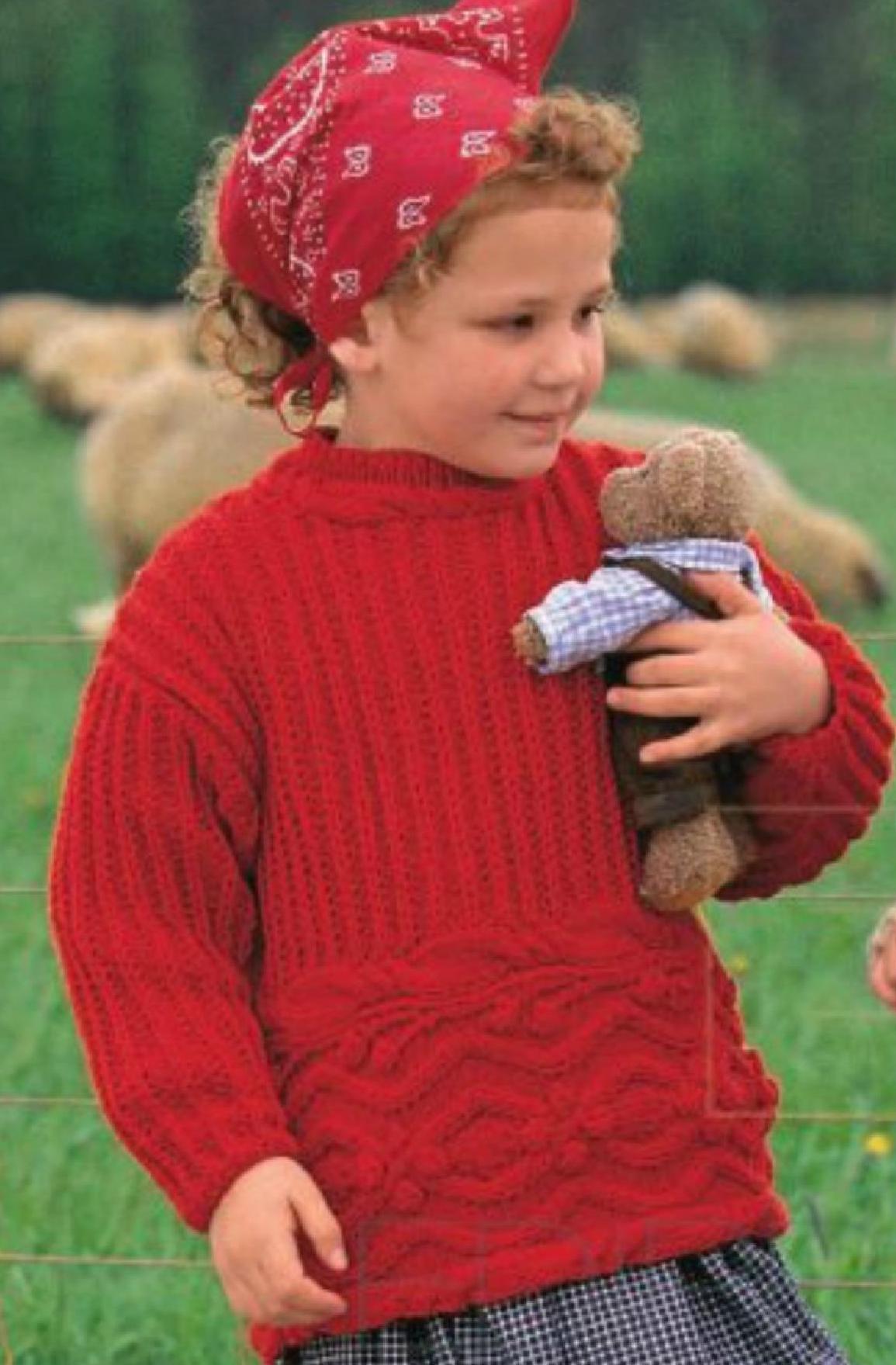 Красный пуловер с рельефными узорами на девочку вязаный спицами