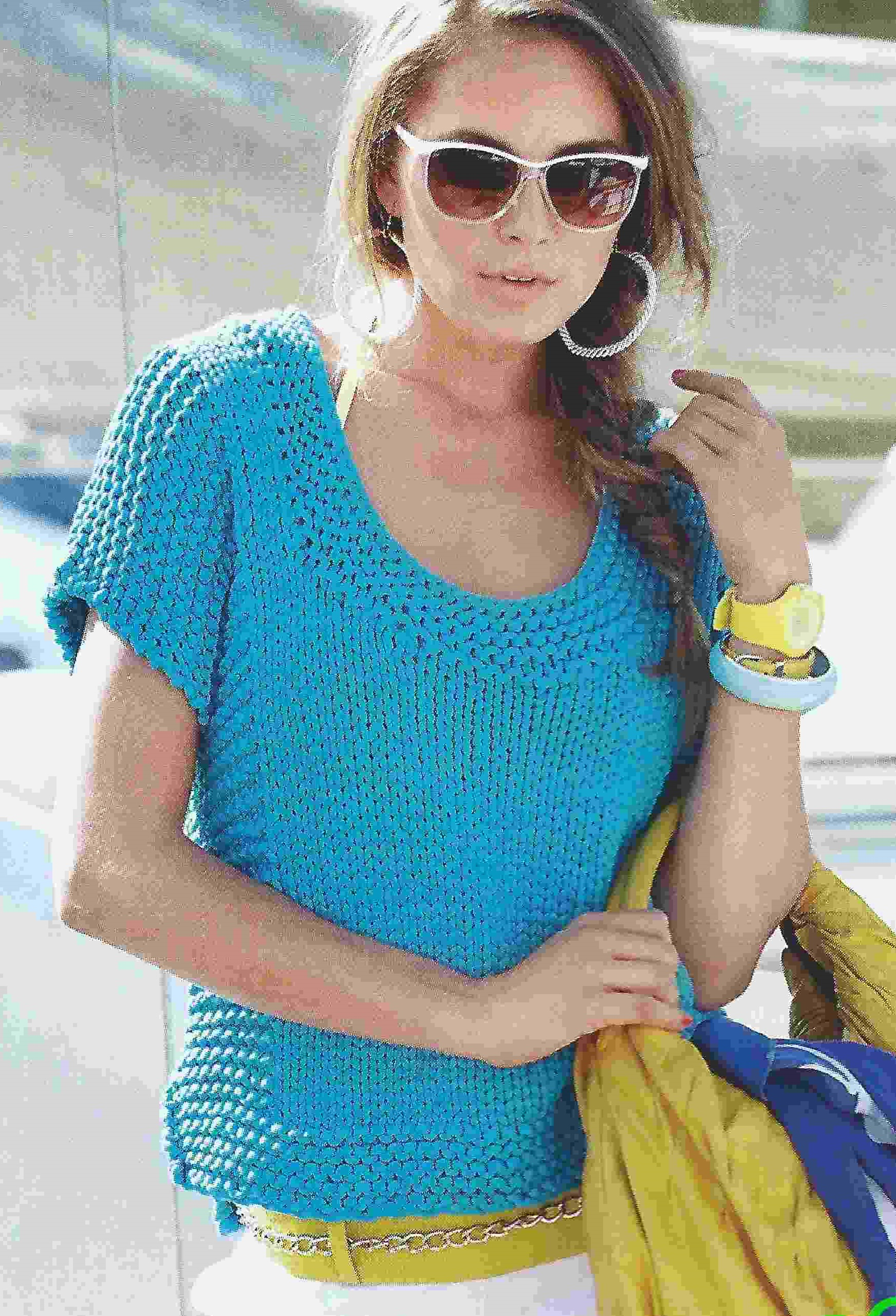 Бирюзовый пуловер вязаный спицами